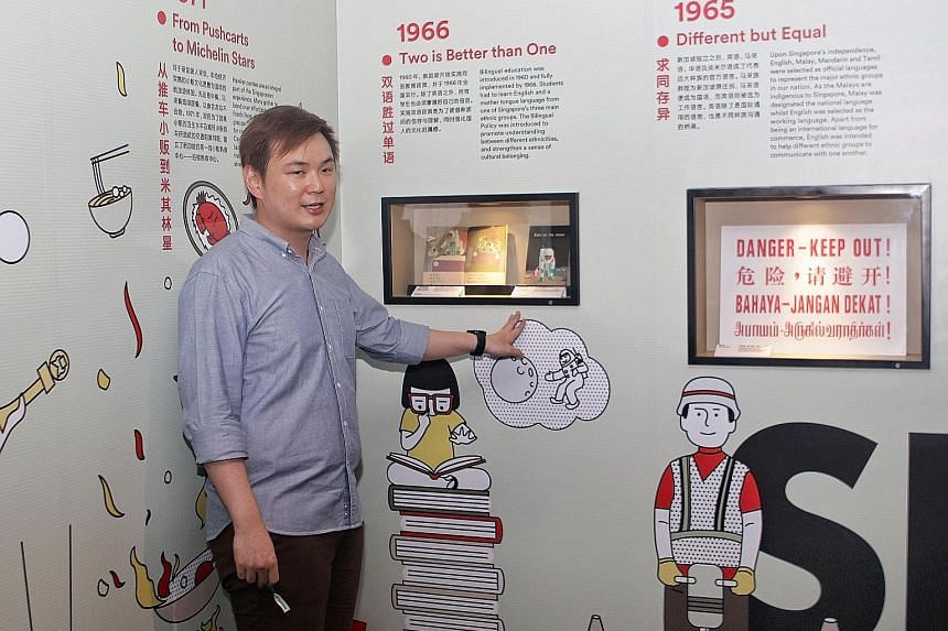 The exhibition's assistant curator Shaun Choh introducing zone 4, which highlights the creative potential of Chinese Singaporeans in reinventing and renewing Chinese culture, to visitors. A visitor at Singapo(ren): Discovering Chinese Singaporean Cul