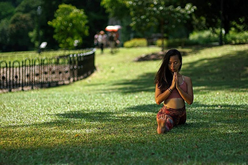Art educator and yoga teacher Tan Wenlin has seen her yoga classes cut by half due to cancellations or postponements. One of her art and movement projects, scheduled for this month and the next, was also postponed indefinitely. But the situation has