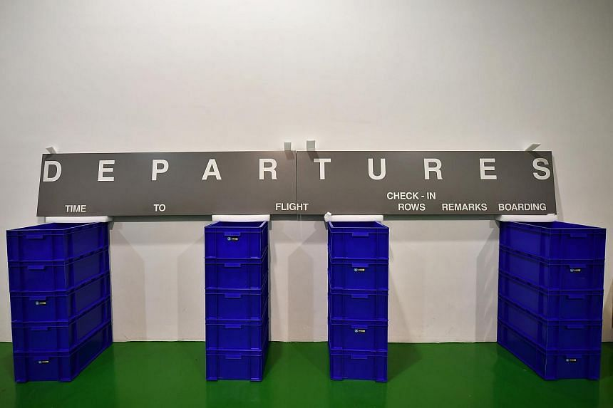 """The """"Departures"""" sign panel sitting inside the storage facility at Global Specialised Services Warehouse on Feb 26, 2020."""