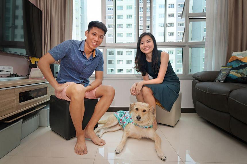 Brenda Chong, 27, her husband, Heah Yong Chian, 29, and their dog, Belle.