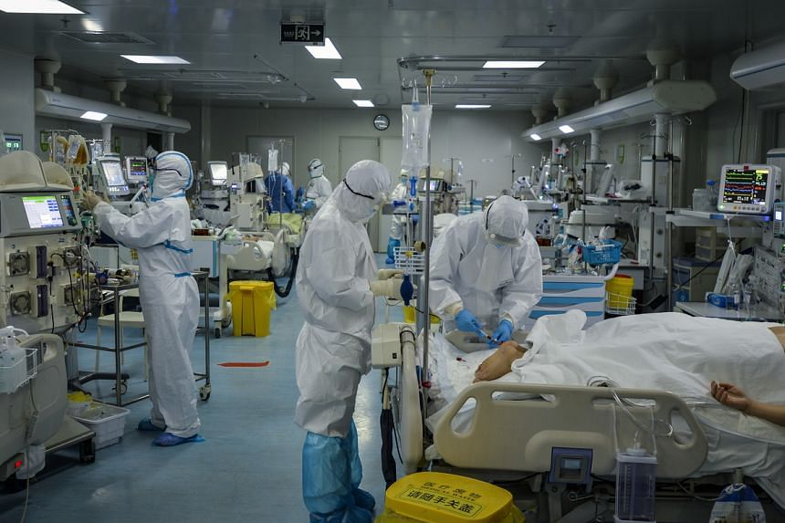 Medical personnel work in the intensive care unit of a hospital designated for coronavirus patients in Wuhan, Hubei province, China, on Feb 24, 2020.