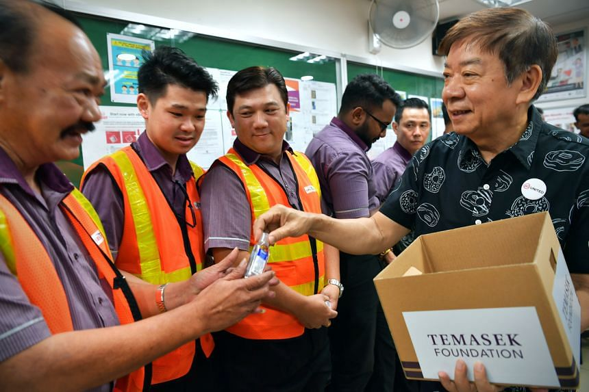 Coordinating Minister for Infrastructure and Minister for Transport Khaw Boon Wan presenting hand sanitisers to transport workers at Toa Payoh Bus Interchange on March 1, 2020.