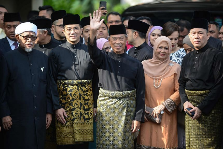 Malaysia's incoming Prime Minister Muhyiddin Yassin (centre) waving outside his residence in Kuala Lumpur before his swearing-in ceremony as the country's new leader.