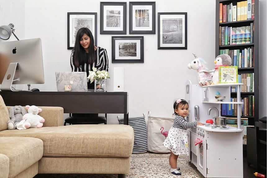 Senior compliance consultant Nasuha Marican works out of a room that also doubles as a play area for her 11-month-old daughter, Noura.