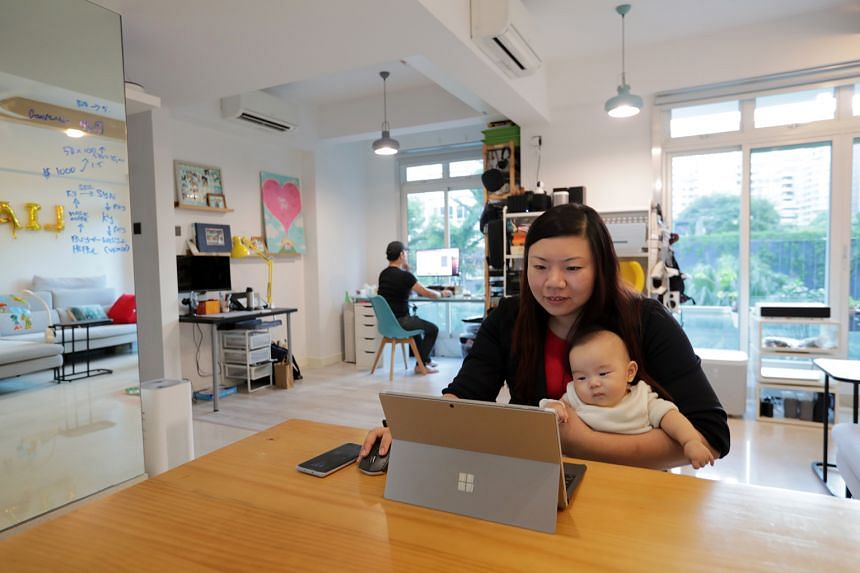 Ms Beatrice Liu-Cheng, who works out of her Balestier apartment, sometimes accompanied by her husband Nicholas Cheng (in the background), while watching over six-month-old Liam