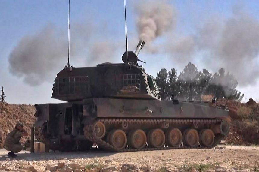 A Turkish self-propelled artillery gun reportedly firing at Syrian regime targets in Idlib province.