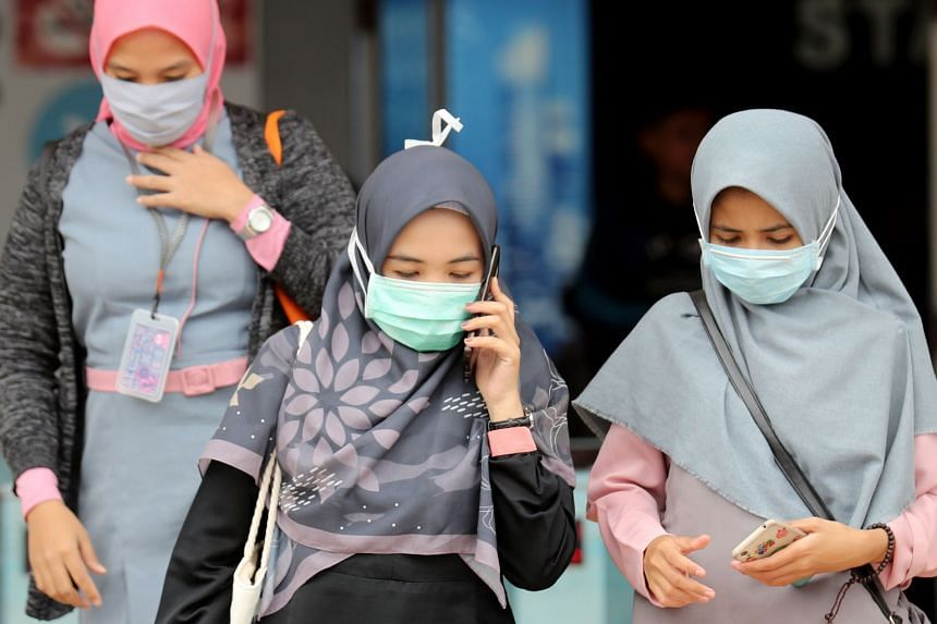Women wear masks in a public area in Depok, West Java, Indonesia, on Feb 29, 2020.