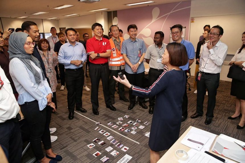 (Centre, from left) Minister of State Zaqy Mohamad, NTUC secretary-general Ng Chee Meng and Senior Minister of State Chee Hong Tat visit Sats staff during training on addressing service lapses to enhance service quality at Sats' learning and develo