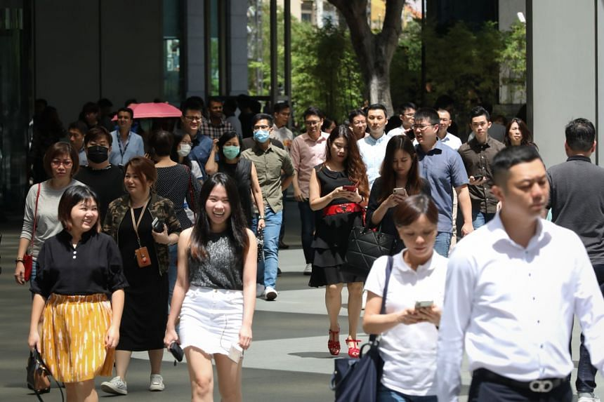 Office workers at Raffles Place on Feb 28, 2020. Experts said the new initiative complements existing efforts but the council could face some challenges in matching workers to jobs.