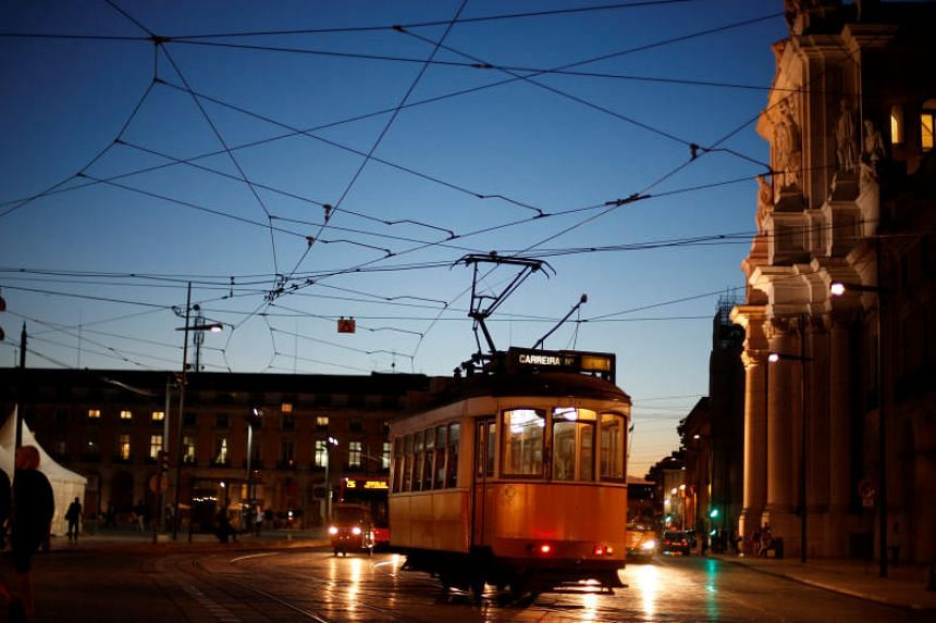 A tram arrives at Praca do Comercio square in Lisbon, Portugal, on Oct 23, 2014. Portugal's first two cases, both men, were taken to hospital in Porto and were in a stable condition and in good general health.