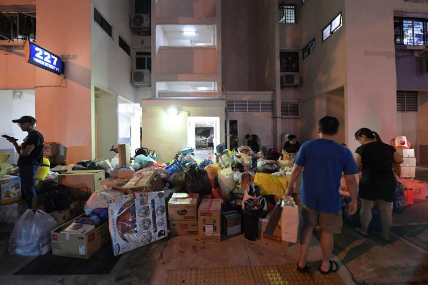 People donating household and other items at Block 227 Yishun Street 21 on Feb 24, 2020. Nee Soon GRC MP Louis Ng had made appeals for donations on Facebook and Instagram.