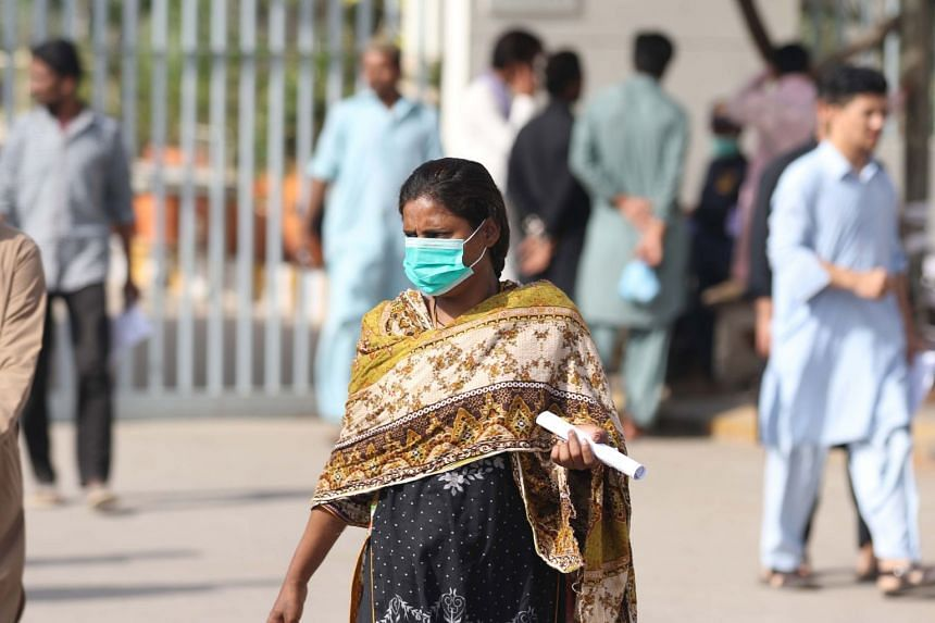 A woman wears a protective face mask in Karachi, Pakistan, on Feb 28, 2020.
