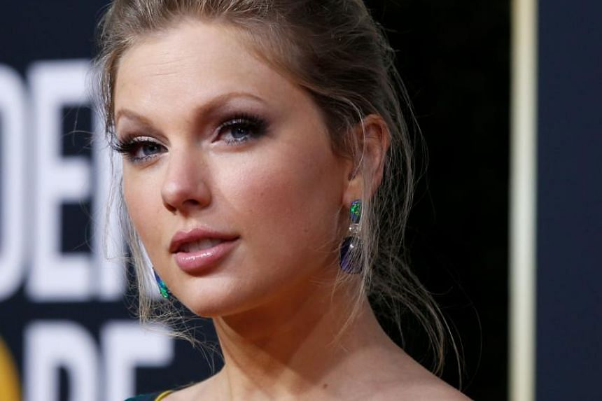 In a photo taken on Jan 5, 2020, American singer-songwriter Taylor Swift arrives on the red carpet at the 77th Golden Globe Awards in Beverly Hills, California.