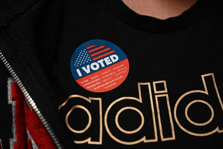 """A voter wears an """"I voted"""" sticker at the YMCA in California on March 2, 2020."""