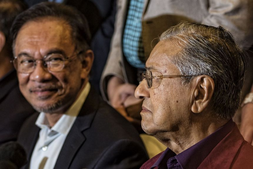 Former prime minister Mahathir Mohamad and Parti Keadilan Rakyat president Anwar Ibrahim (both above), key figures in Pakatan Harapan, have kept a low profile since Malaysia's new prime minister was sworn in.