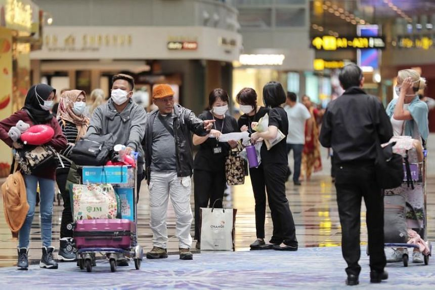 People with surgical masks in Changi Airport Terminal 3 on Feb 13, 2020. The Immigration and Checkpoints Authority said it had issued 4,535 stay-home notices as of Tuesday morning (March 3).