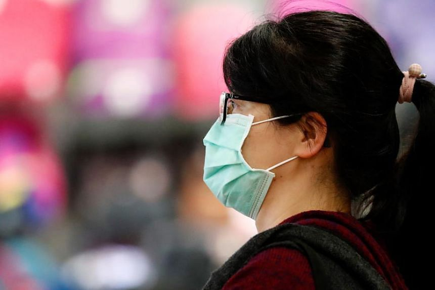 A Taiwanese person wearing a mask as a precautionary measure walks in the street, in Taipei, Taiwan, on Feb 27, 2020.