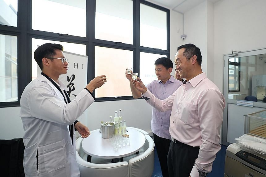 (From left) SinFooTech chief executive Jonathan Ng and Senior Ministers of State for Trade and Industry Chee Hong Tat and Koh Poh Koon trying out Sachi - an alcoholic beverage fermented from soya whey, a by-product of tofu that is currently disposed