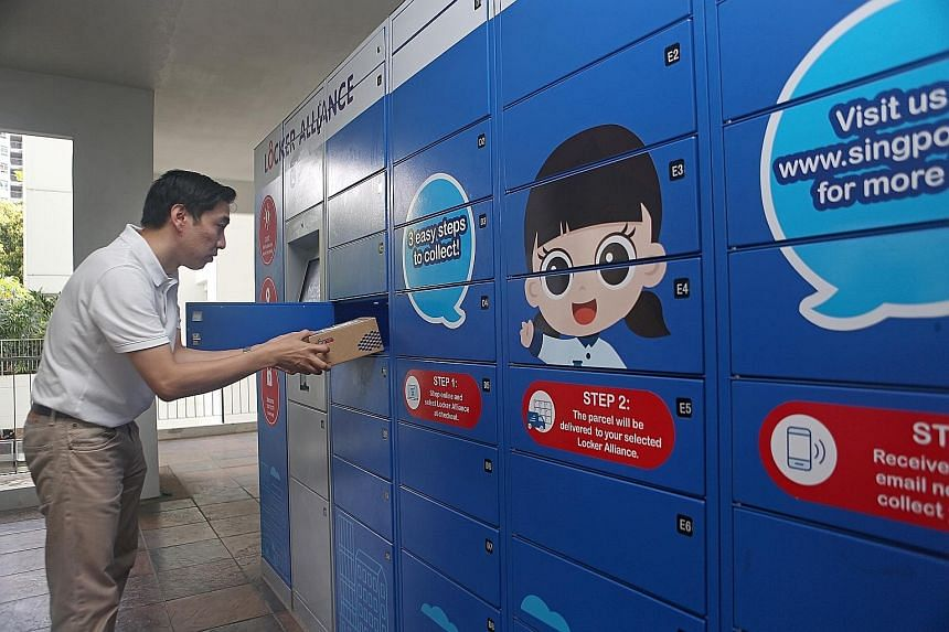 A resident collecting a parcel from a parcel locker station in Punggol last week. The nationwide roll-out follows a successful trial launched in December 2018 by the Infocomm Media Development Authority. For the trial, 62 locker stations were deploye