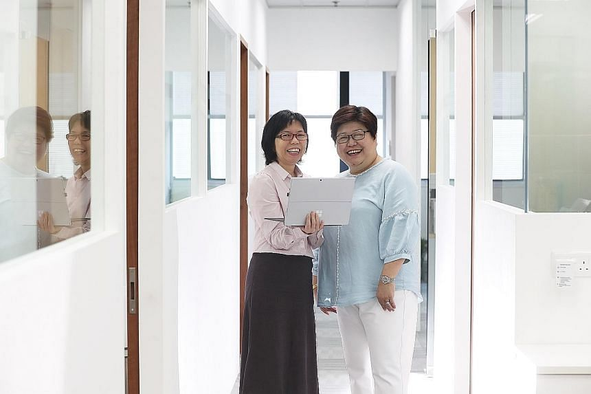 Ms Janna Chui with her boss Emerlin Toh (far right). After Ms Chui underwent the professional conversion programme for Microsoft SQL server administrator or developer, Ms Toh, managing director of Reach Technologies, felt she had held her own and pro
