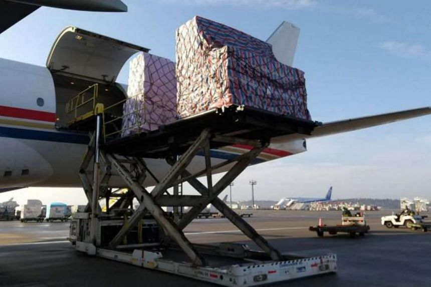 A jet's cargo of donated masks is off-loaded at Narita International Airport in Tokyo, on March 3, 2020.