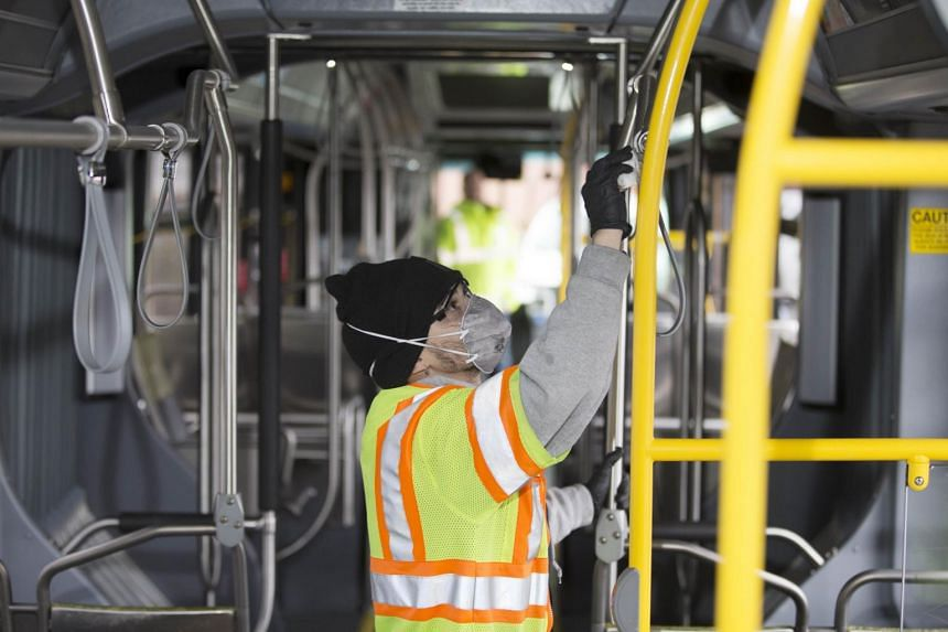 A utility service worker for King County Metro Transit deep cleans a bus at the King County Metro Atlantic/Central operating base in Seattle on March 3, 2020.