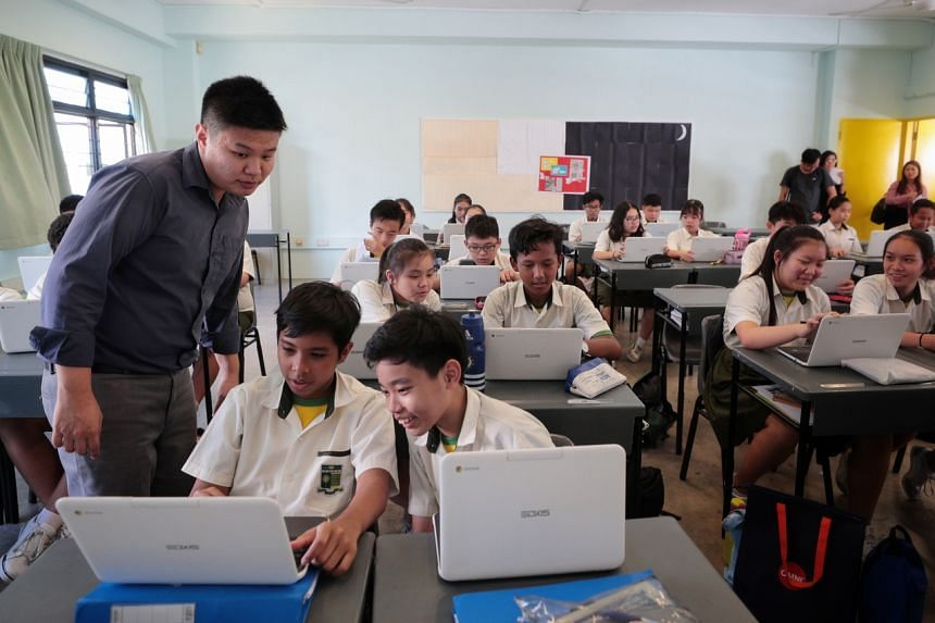 Orchid Park Secondary School students using Google Chromebooks as part of a mathematics lesson, taught by teacher Marwin Low (left), on Feb 26, 2020.