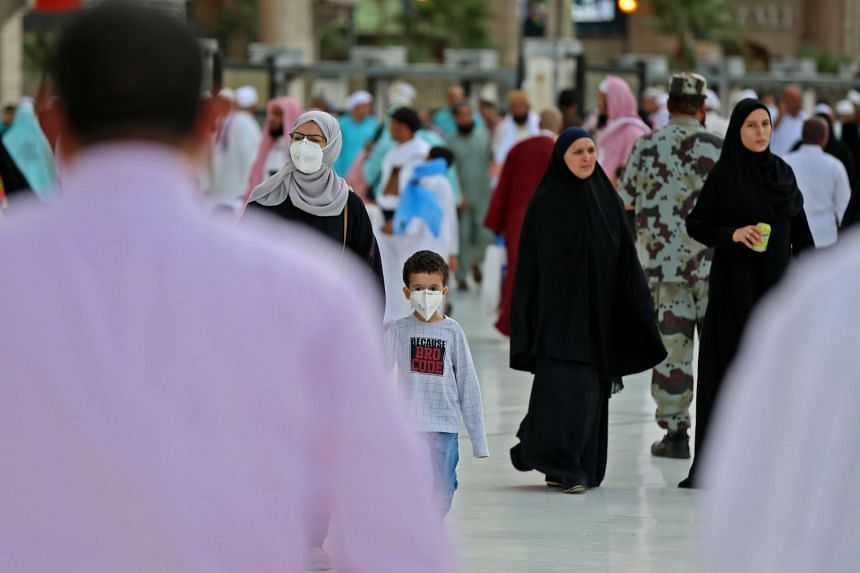 Muslim pilgrims wear masks at the Grand Mosque in Saudi Arabia's holy city of Mecca on Feb 28, 2020.
