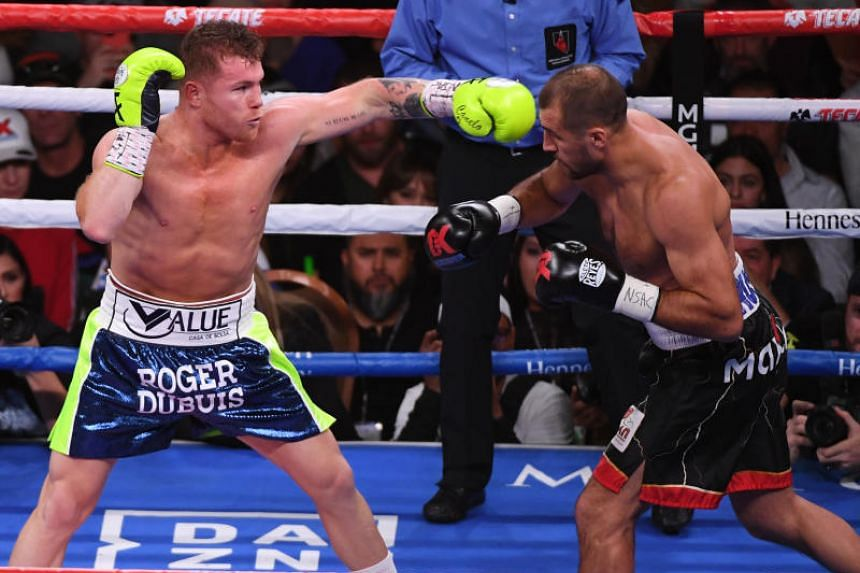A photo taken on Nov 2, 2019, shows Canelo Alvarez (left) and Sergey Kovalev in the third round their WBO light heavyweight title fight at MGM Grand Garden Arena in Las Vegas.