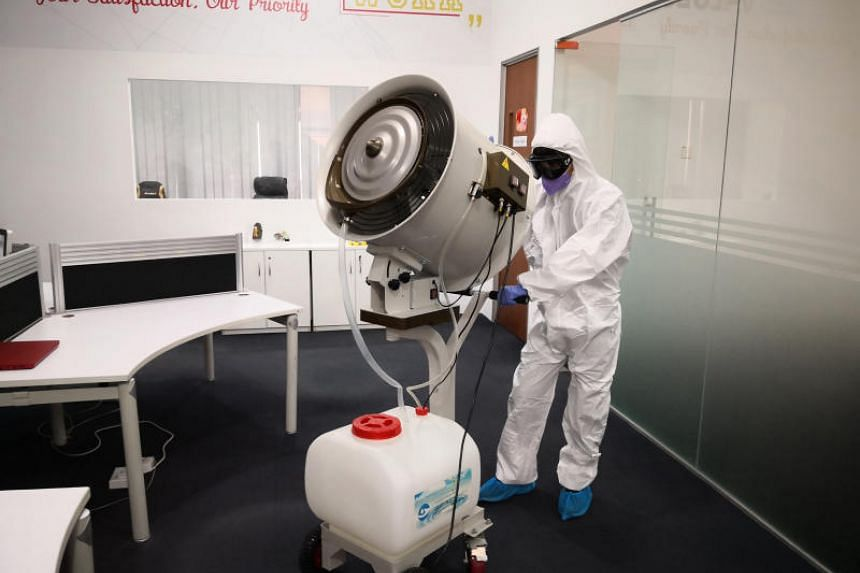 A disinfection specialist from Clean Lab carrying out decontamination treatment to a large office space. Cleaning and disinfection companies such as Clean Lab have seen takings climb by up to 70 per cent.