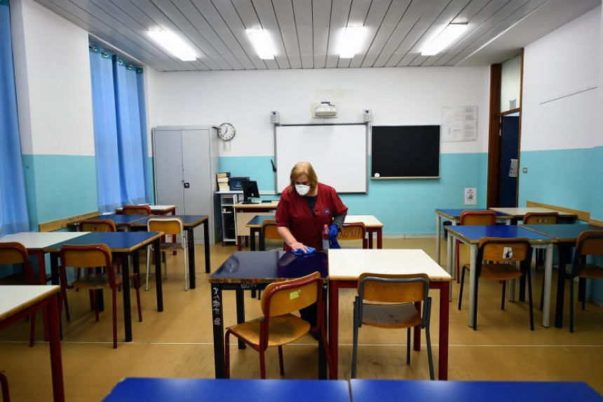 A cleaner sanitising a classroom at the Piero Gobetti high school in Turin, Italy, on March 2, 2020.