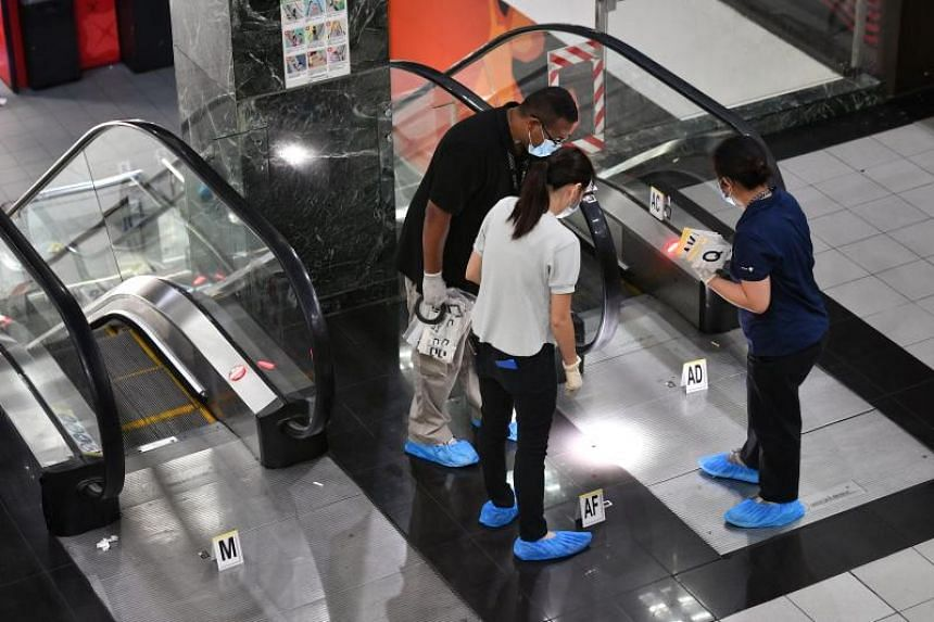 Police officers investigating the crime scene at Orchard Towers on July 2, 2019.
