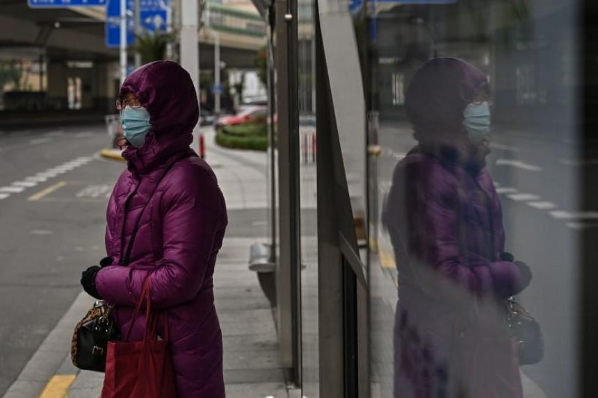 A woman wearing a face mask in Shanghai on March 3, 2020. The round 11 meeting, which was to take place in Shanghai's Jiangwan Stadium, will now be played on June 7 at the Docklands Stadium in Melbourne.
