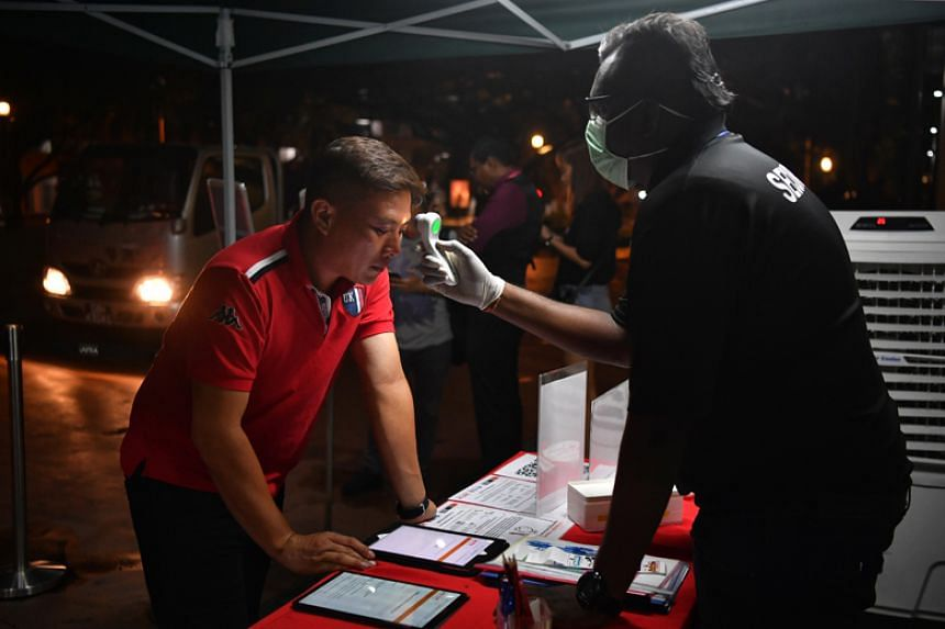 A visitor having his temperature checked at the entrance of Safra Jurong on March 5, 2020.