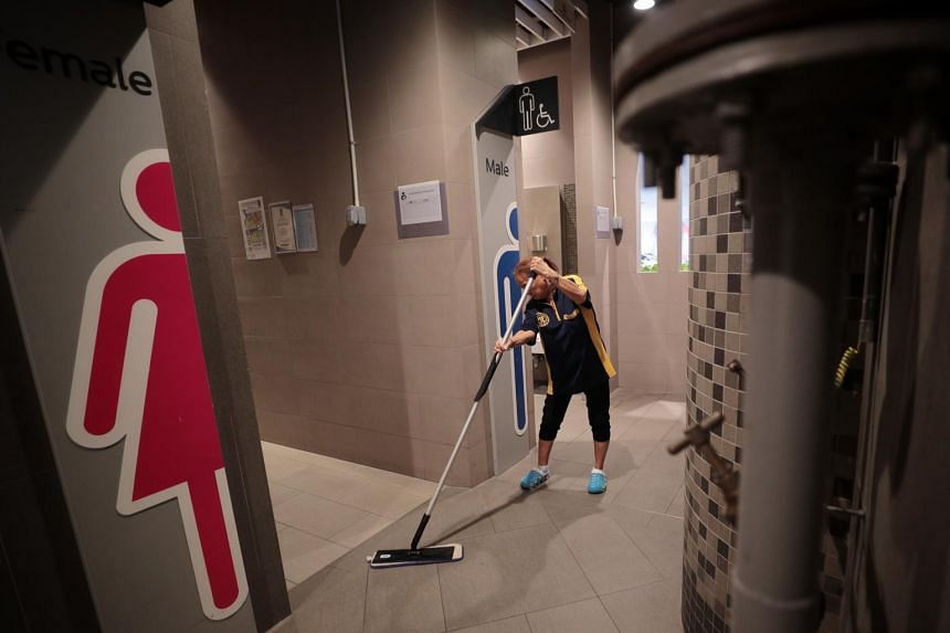 A cleaner cleans the toilets at the hawker centre at Our Tampines Hub on Feb 16, 2020.