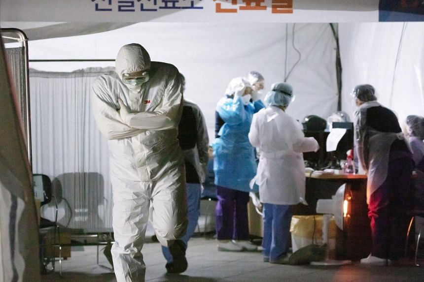 Medical workers at a special facility set up to treat coronavirus patients at a public hospital in Seoul, on March 4, 2020.