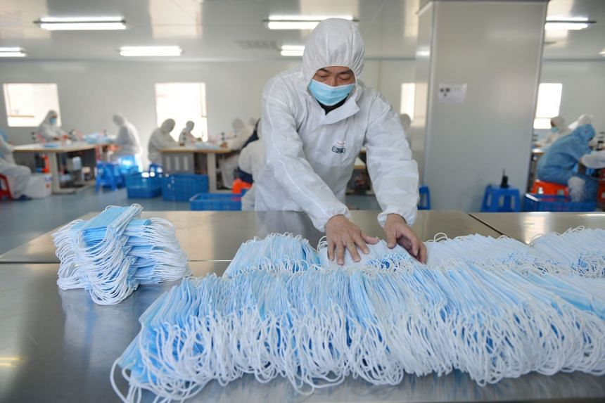 A worker sorting face masks at a factory in Nanjing, China, on Feb 18, 2020. Foreign Ministry spokesman Zhao Lijian said China has sent testing equipment to Iran, Pakistan, Japan and some African countries.