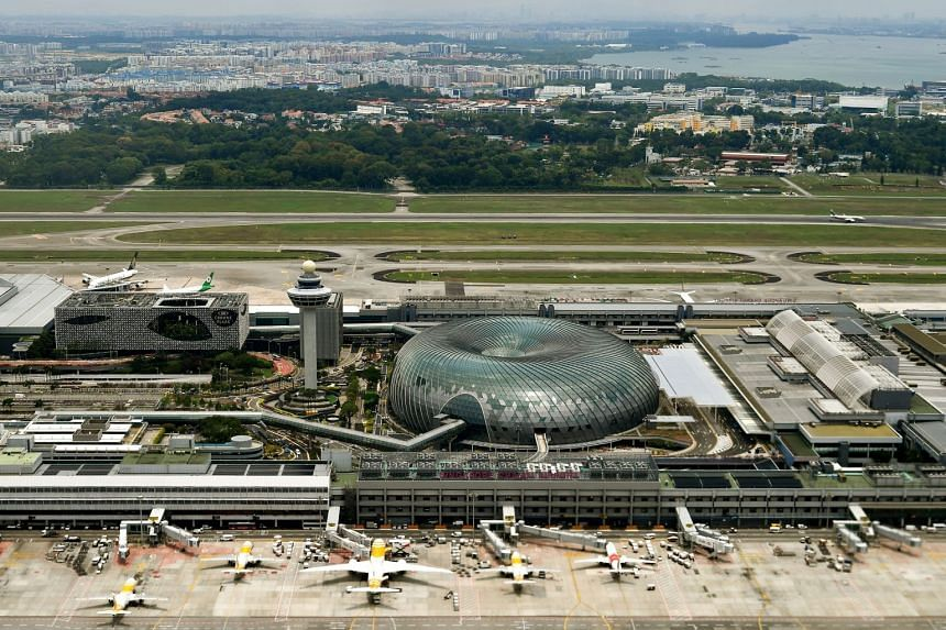 A 2019 photo shows the Crowne Plaza hotel, Jewel, and the control tower at Changi airport.