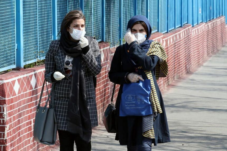 Iranian women walking on a street of Teheran, on March 5, 2020. The death toll from coronavirus in Iran now exceeds 100.