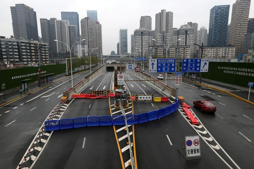 The Wuhan Yangtze River Tunnel is seen blocked with a barrier on Jan 25, 2020, following the city's lockdown.