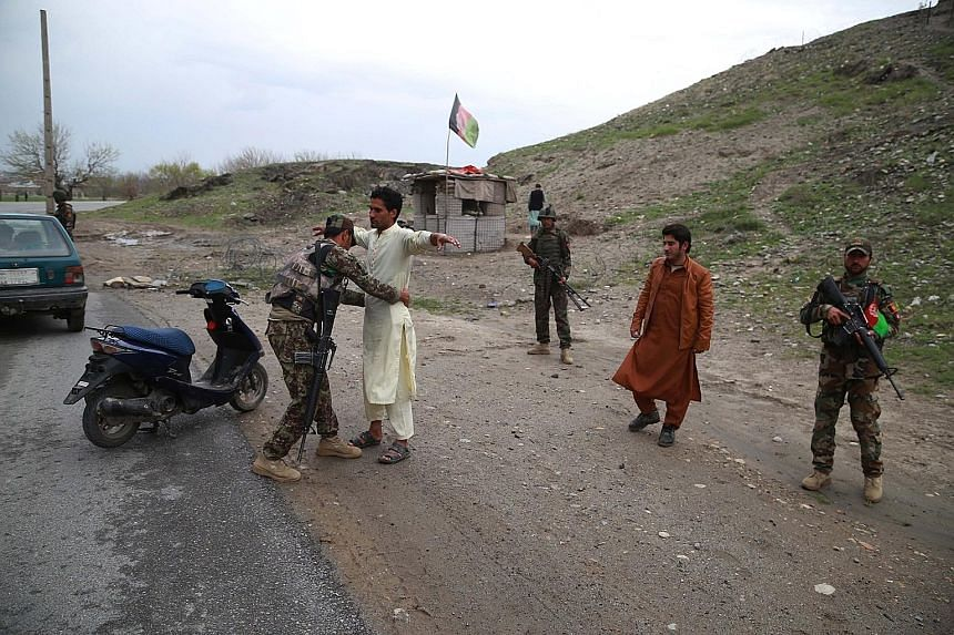 Security officials conducting a body search at a checkpoint in Nangarhar province, Afghanistan, on Wednesday. The International Criminal Court's ruling comes days after the Taleban killed at least 20 Afghan soldiers and policemen in overnight attacks
