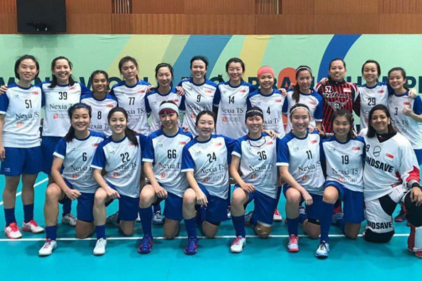 Captain Michelle Lok (front, third from left), vice-captain Debbie Poh (back, second from left) and the rest of the Singapore team at the Women's World Floorball Championship in Neuchatel, Switzerland in December 2019, when they ended 12th.