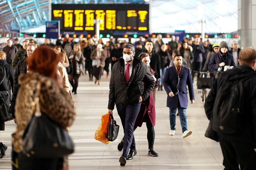 A man is seen wearing a protective face mask at the Waterloo station in London, Britain, on March 6, 2020. The number of people infected with the new coronavirus across the world surpassed 100,000.