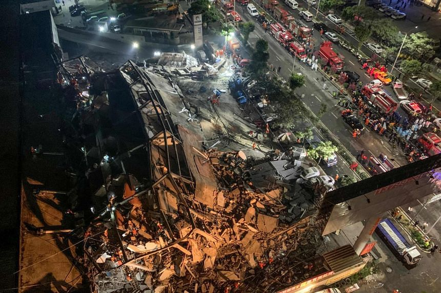 Around 70 people were trapped after the Xinjia Hotel collapsed (above) on March 7 evening, officials said.