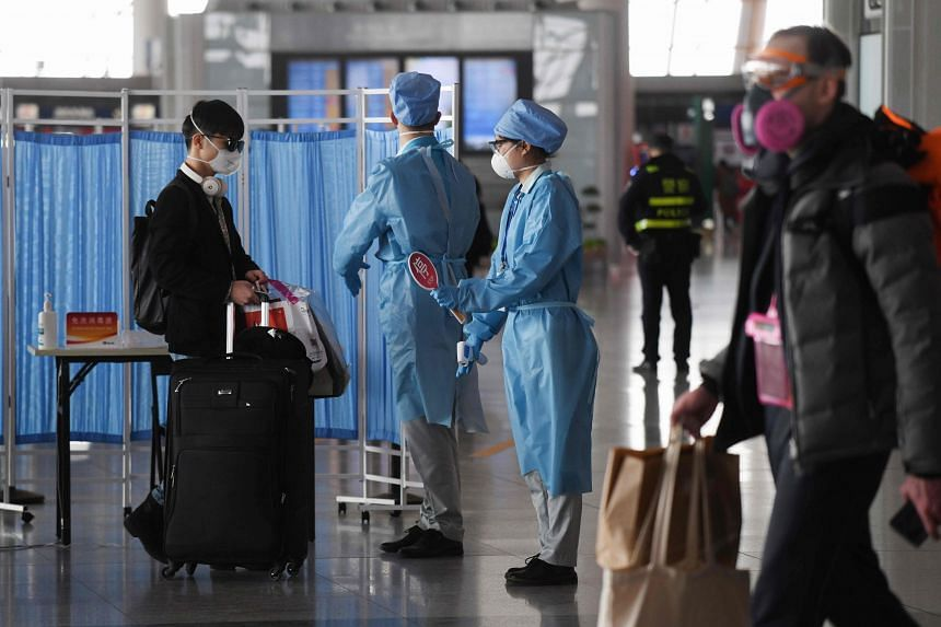 A passenger arriving at Beijing Capital International Airport on March 5, 2020. Beijing mandates a 14-day quarantine for inbound travellers from overseas coronavirus hotspots, in addition to related quarantine checks and inquiries.
