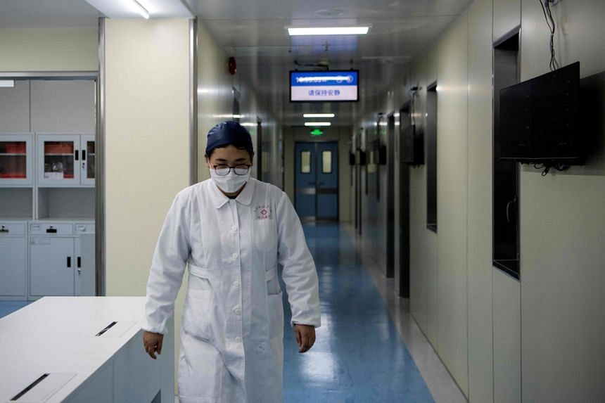 A nurse walks inside the Shanghai Public Clinical Centre in Shanghai on Feb 17, 2020. Women reportedly account for the majority of nurses and doctors on the front line.