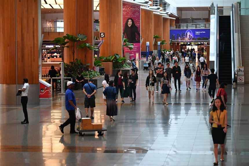 Visitors at the departure hall of Changi Airport Terminal Two on Feb 21, 2020.