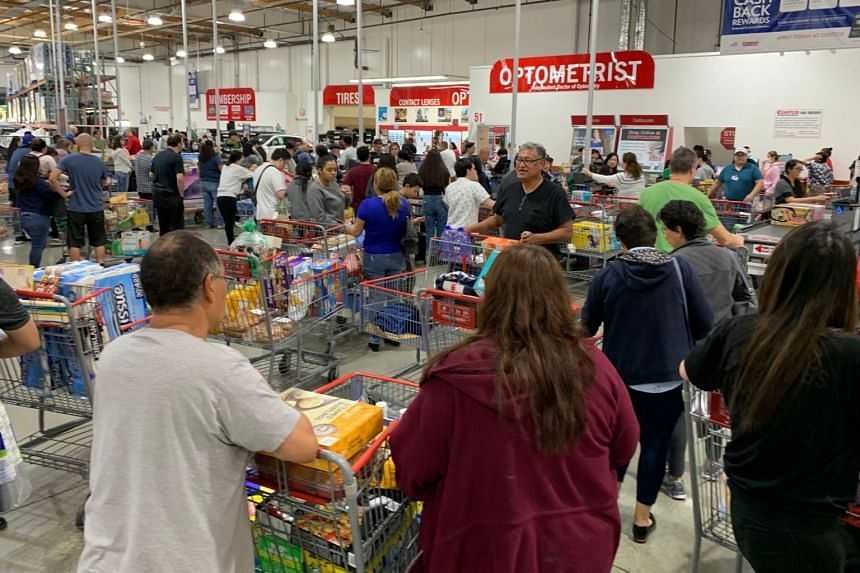 People begin to panic-buy and stockpile essentials from fear that supplies will be affected by the spread of the Covid-19 coronavirus outbreak across the country, in Los Angeles, on Feb 29, 2020.