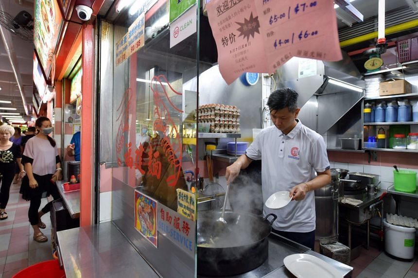 Mr Johnny Tng's Super Mummy stall is selling Hokkien mee for $4 or $6 a plate - a dollar off the usual price.
