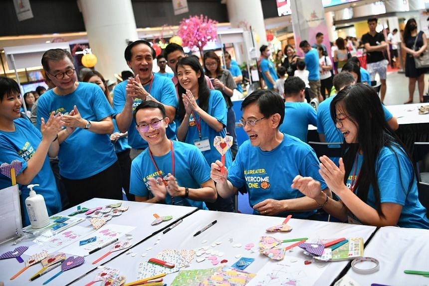 """Deputy Prime Minister Heng Swee Keat with an origami heart he made during the launch of the """"Overcome as One"""" movement at Our Tampines Hub on March 7, 2020."""